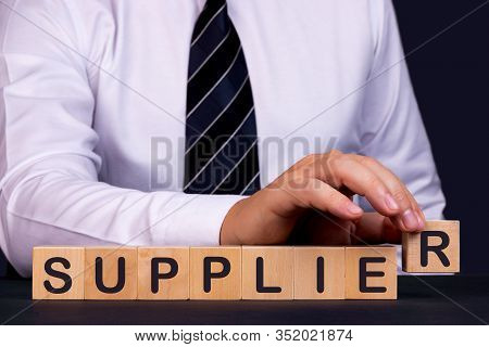 Man Made Word Supplier With Wood Blocks
