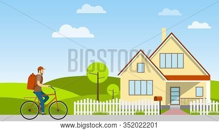 The Postman Carries Mail On A Bicycle. Postman Rides A Bicycle Against The Backdrop Of A Rural Lands