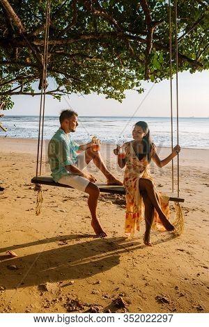 Hammock On The Beach Krabi Thailand, Couple In Swing On Ao Nang Beach Thailand Krabi