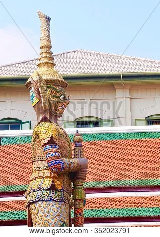 Thai Guardian Giant Or Gate Guardian Holding Big Clubs At Wat Phra Kaew And The Grand Palace In Bang