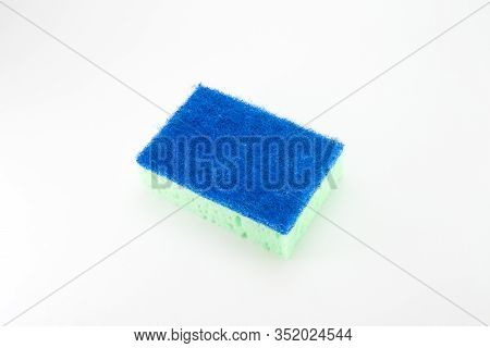 Sponge For Washing Dishes In Light Green With A Blue Abrasive Part On A White Isolated Background. R