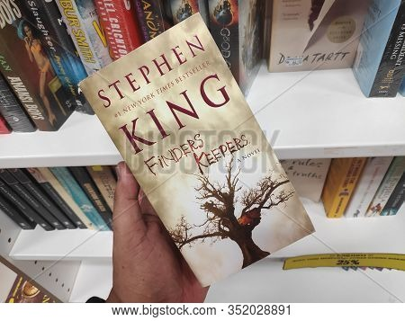 Kulim, Malaysia - A Hand Holding A Stephen King Book Title Finders Keepers.