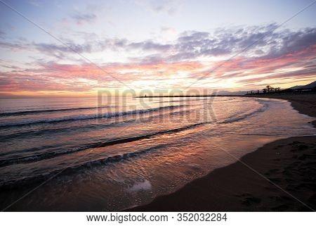 View Along The Shoreline Towards Marbella At Sunset, Puerto Cabopino, Marbella, Costa Del Sol, Malag