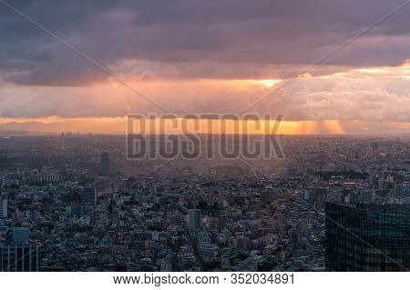 Aerial View Of Tokyo Cityscape At Sunset. Modern Urban Sprawl City Background With Buildings To The