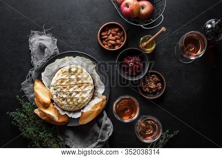 Baked Brie Served In A Rustic Manner With Honey Walnuts Cranberry Jam And Rose Wine, Top Down View O