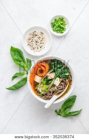 Bok Choy And Tofu Vegetarian Udon Noodles Soup Seasoned With Chives And Sesame Seeds, View From Abov