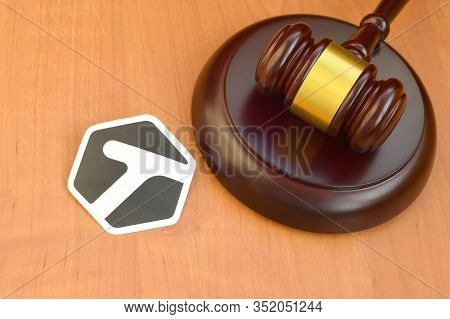 Tagged Paper Logo Lies With Wooden Judge Gavel. Entertainment Lawsuit Concept