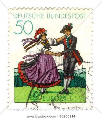 Germany- Circa 1981: Stamp Printed By Germany, Shows South German Couple Dancing In Regional Costume