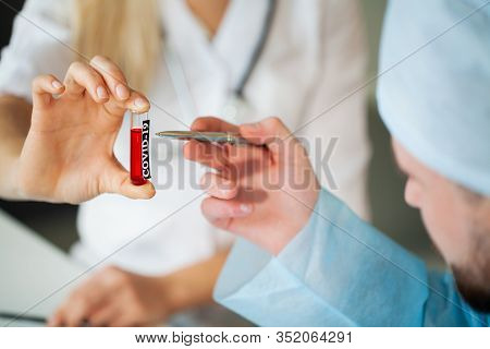 Closeup Of Doctor Holding Test Tubes With Coronavirus Assay
