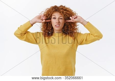 Silly Displeased Cute Redhead Curly Girl Shut Her Ears, Plug Fingers Into Earholes And Squinting, Cr