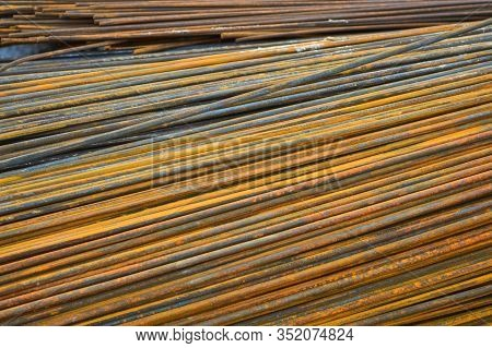 Iron Metal Rusty Yellow Bars Of Industrial Building Reinforcement From Corrugated Reinforcement For