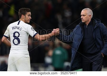 LONDON, ENGLAND. 19 FEBRUARY 2020. Harry Winks shakes hands with Jose Mourinho of Tottenham during the UEFA Champions League match between Tottenham Hotspur and RB Leipzig