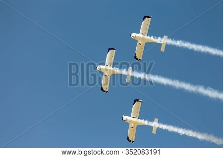 Aerobatic Team Of 3 Planes Flying In Formation.