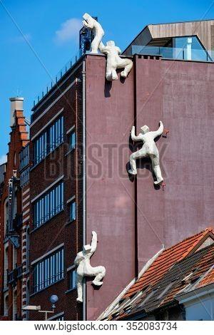 ANTWERP, BELGIUM - MAY 26, 2018: De fluisteraar (The whisperer) statue in Antwerp, Belgium