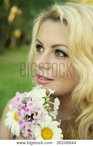 blonde woman with flowers