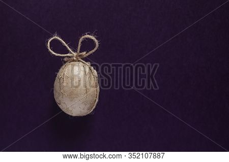 A Single Aster Egg Decorated With Crafty Paper And Ribbon On The Dark Background