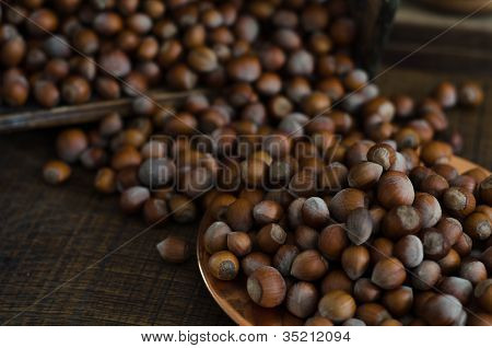 Hazelnuts In Motion Tumbling Into Wooden Box