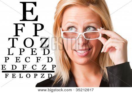 Wondering Businesswoman Looking At An Eyechart