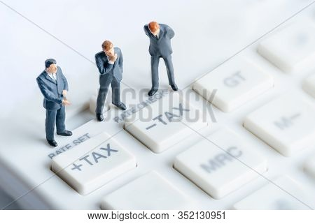 Business Mans Standing On Calculator. Calculation And Tax Payment. Interest Rate Financial And Mortg