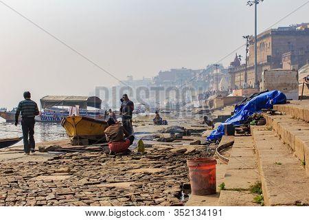 Varanasi, India - January 29, 2020: Local Indian Casual Morning Life On Ganga River In Varanasi. A B