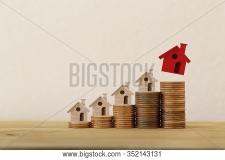 Arrange Red Outstanding Small House Or Home On Stacks Of Coins, Property Investment Real Estate / Ho