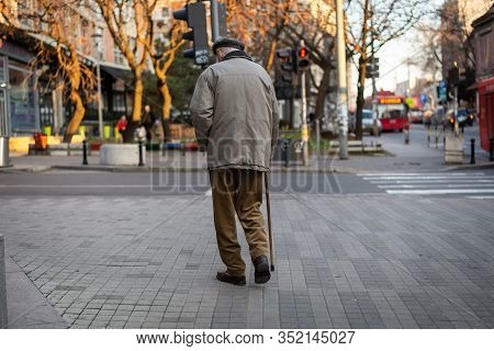Old Man Walking. Pensioner Lifestyle. Rear View Of Old Man Walking Lifestyle. Old People Lifestyle.