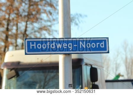 Blue And White Direction Sign On The Hoofdweg Heading To Rotterdam Nesselande And Nieuwerkerk Aan De