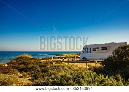 Camper, Recreational Vehicle On Mediterranean Coast In Spain. Camping On Nature Beach. Holidays And