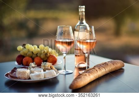 Bottle Of Rose Wine And Two Full Glasses Of Wine On Table In Heart Of Provence, France With French B