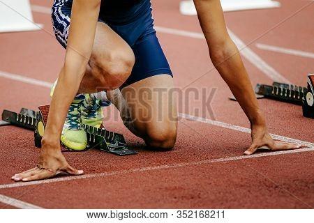 Man Athlete Runner On Starting Line Run Sprint From Starting Blocks