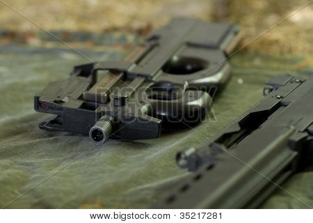 Automatic Rifle Lying On The Ground