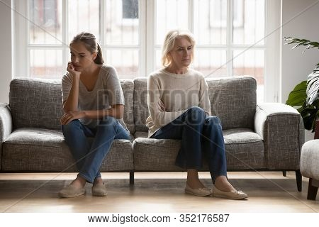 Grown Up Daughter And Retired Mother Ignoring Each Other.