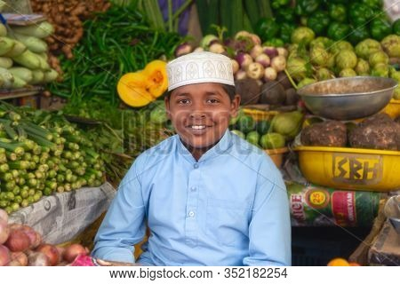 Ooty, India - August 25, 2018: Portrait Of A Smiling Muslim Boy In His Vegetable Store At The Ooty M