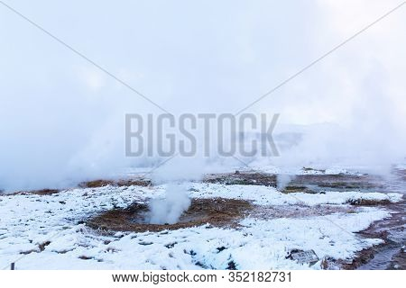 An Erupting Soaring Geyser In The Valley Of Geysers. Magnificent Iceland In The Winter.
