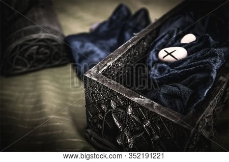 Closeup Of Occult Mystic Rune Stones On Blue Velor Silk In An Occult Box For A Pagan Psychic Destiny