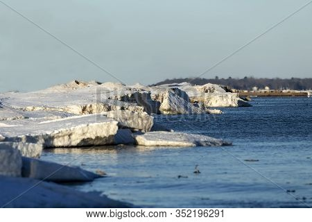 The Shores Of Lake Michigan Are Covered By An Ice Barrier