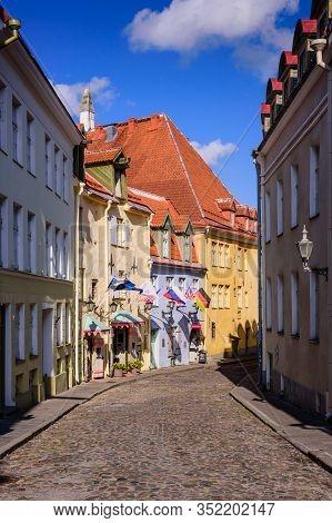 Tallinn, Estonia - August 2, 2019: Sightseeing Of Tallinn. Traditional Street With Old Buildings In