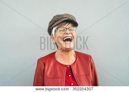 Happy Senior Woman Laughing Outdoor - Trendy Mature Person Having Fun During Retired Time - Elderly