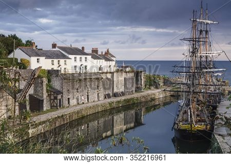 Tall Ships Docked In Historic Charlestown Harbour On The Coast Of Cornwall, England
