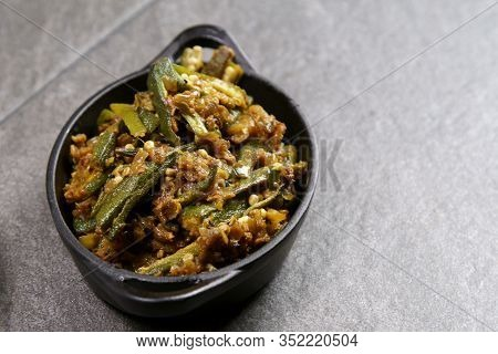 Bhindi Masala Or Stuffed Bhindi Or Okra, An Indian Vegetable  On A Plate With Copy Space.