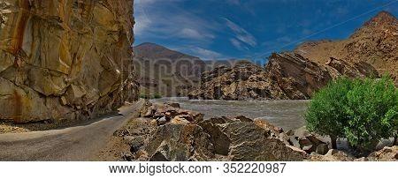 Central Asia, Tajikistan. Border River Panj Between Tajikistan And Afghanistan Along The Pamir Tract
