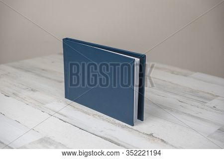 Navy Blue Leather Album Book - Blank Cover On Isolated White Wooden Background
