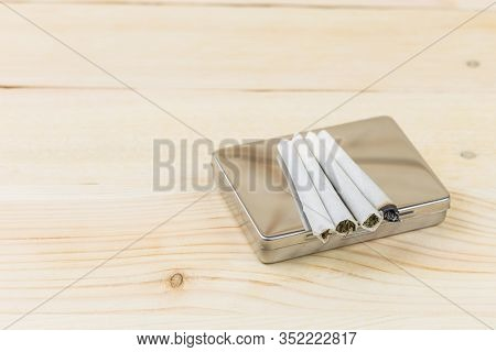 Hashish Joint On Wooden Background Cigarette Box For Smoking.
