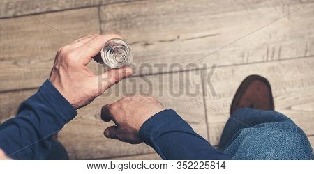 The Man Hand Holding A Glass Of Vodka. Alcocholism Concept With Copy Space. The Stressed Man Relaxin