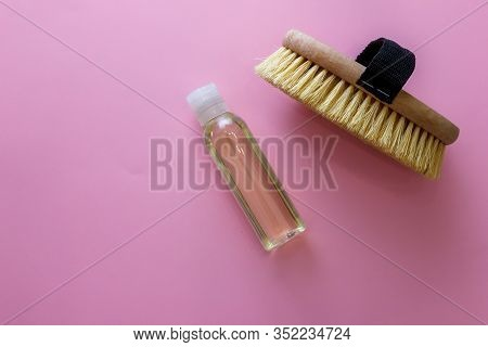 Spa Organic Brush For Dry Massage And A Bottle Of Body Oil On Pink Background. Cactus Brush And Jar