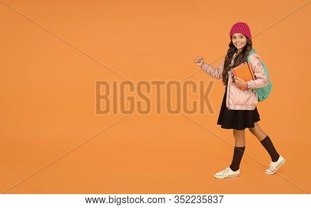 School Is Back. Happy Small Child Back To School. Little Girl Go To School Orange Background. Back T