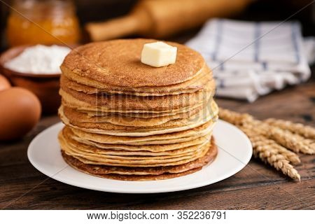 Stack Of Blini, Russian Thin Pancakes Or Crepes With Butter On Old Rustic Wooden Table. Maslenitsa,