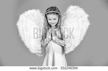 Child With Angelic Face. Cute Child Girl Posing With Angel Wings. Beautiful Little Angel Girl Standi