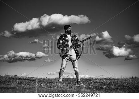 Hunter With Shotgun Gun On Hunt. Hunting Equipment For Professionals. Hunting Is Brutal Masculine Ho