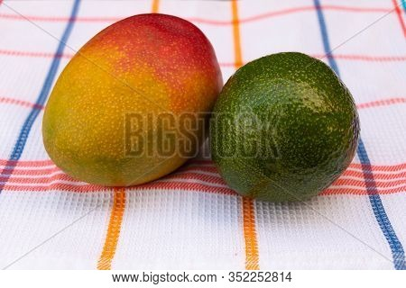 Mango And Avocado Fruits Together. Fruit Beneficial For Health Concept